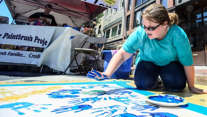 Maggie Oâ??Brien, 11, from Greene, uses her hands to help paint a picture at the Magic Paintbrush Project booth during the 52nd annual July Fest in downtown Binghamton.  KRISTOPHER RADDER / Staff Photo Maggie OâÂ?Â?Brien, 11, from Greene, uses her hands to help paint a picture at the Magic Paintbrush Project booth during the 52 annual July Fest in downtown Binghamton.