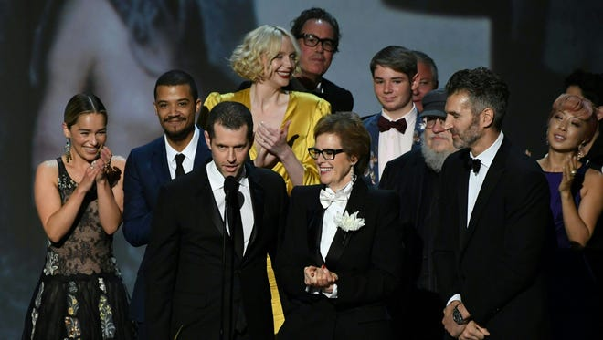 """Writer-producer D.B. Weiss (C-L) and the cast of """"Game of Thrones"""" accept the award Outstanding Drama series onstage during the 70th Emmy Awards at the Microsoft Theatre in Los Angeles on Sept. 17, 2018."""
