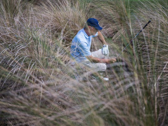 Gary Hallberg decides which club to use to get his ball out of the rough during the Chubb Classic in Naples on Friday, February 16, 2018.