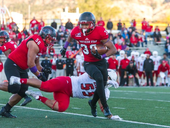 Southern Utah's Terrance Beasley runs for yardage during