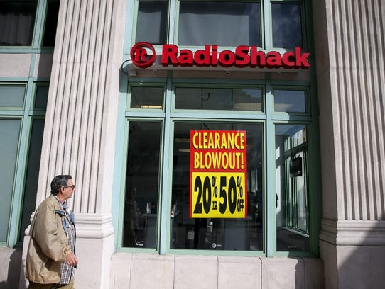 """A sign reading, """"Clearance Blowout,"""" is seen in the"""