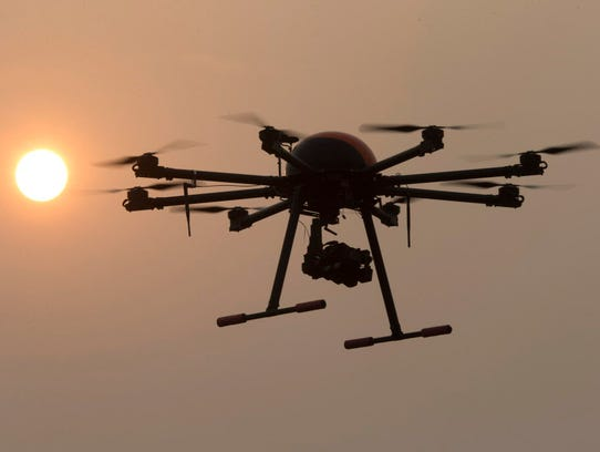 A drone hovers Oct. 17, 2015, with the sun in the background