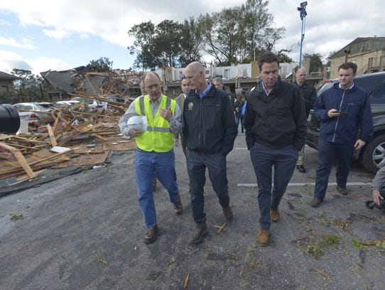 Gov. Rick Scott and local officials tour the damage