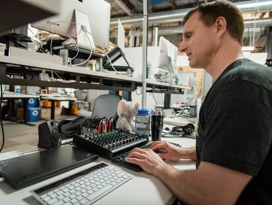 Facebook engineer Matt King at his desk in the company's
