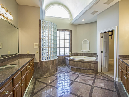 The huge master bath is luxury retreat within the home.