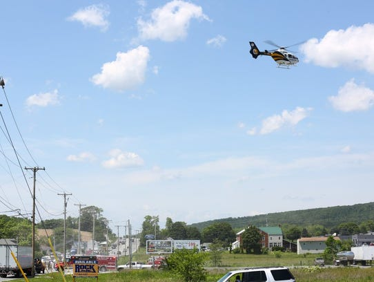 A medical helicopter takes off from the scene of a