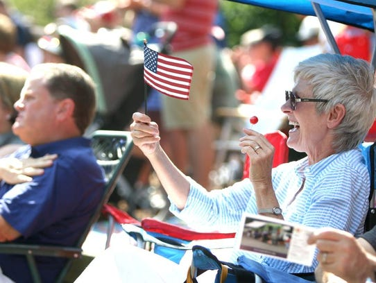 Kay Braisdell of Black Mountain waves her flag during