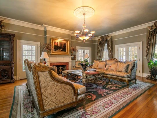 The updated den and family room is comfort and luxury