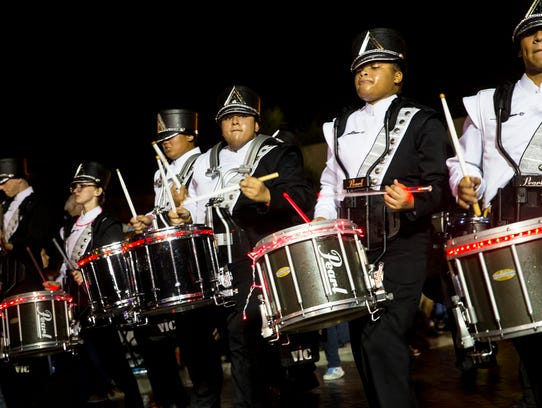 The Mariner High School Marching Band drumline performs