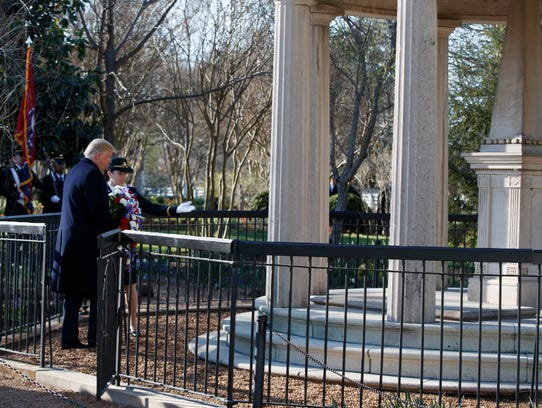 President Donald Trump lays a wreath at the Hermitage,