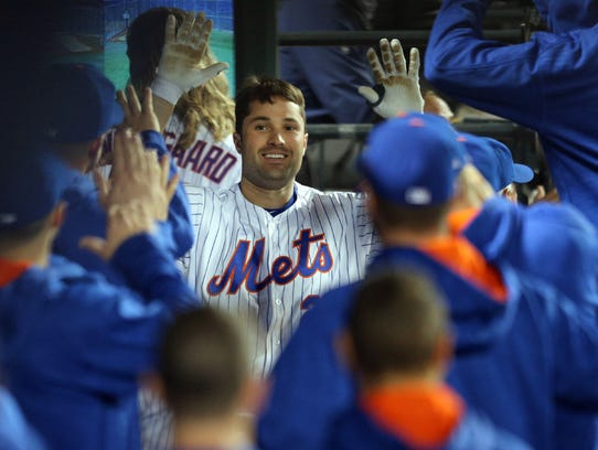 Neil Walker is congratulated by teammates after hitting