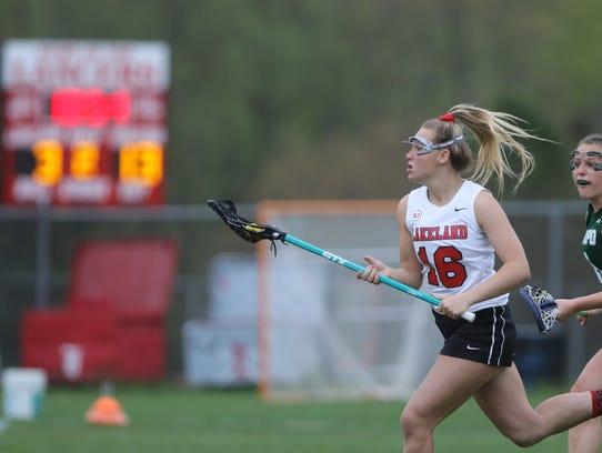 Lakeland leading scorer Madison Burgner tries to run