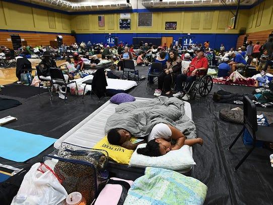Local residents take shelter at the Pedro Menendez