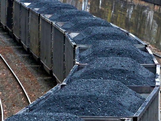 A train hauls coal through Pittsburgh in January 2017.
