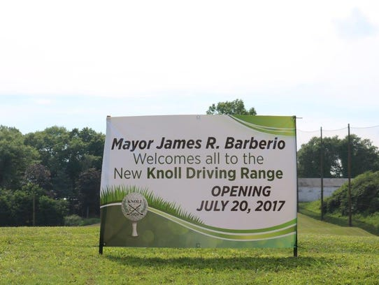 A sign is placed on opening day of the new driving