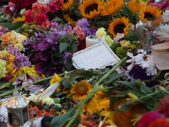 A note written to Heather Heyer sits among flowers