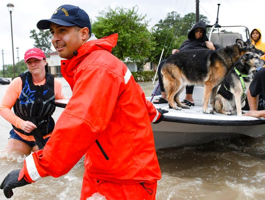 Volunteers and first responders work together to rescue