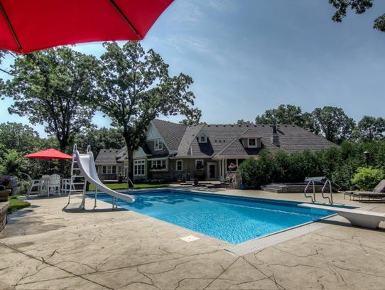 An in-ground pool is one feature of the property at