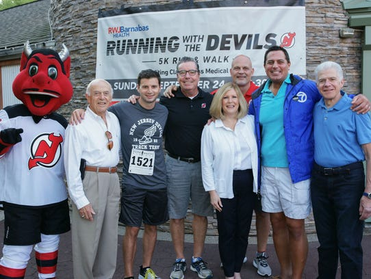 From left: The New Jersey Devils mascot; Lou LaSalle,