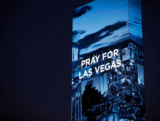 The marquee at the W Hotel shows a sign for the victims