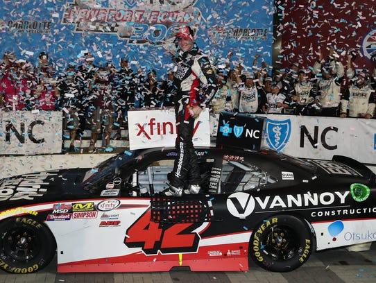 Alex Bowman celebrates after winning an XFinity Series