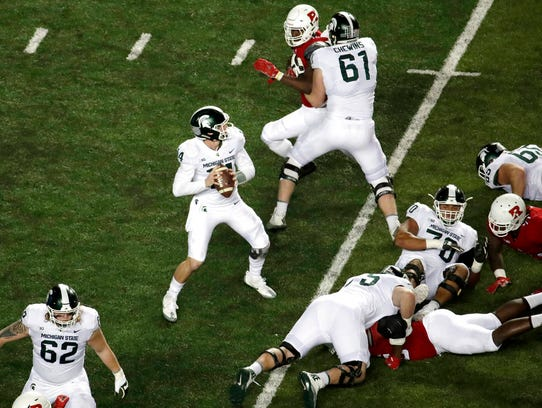 Michigan State quarterback Brian Lewerke (14) looks