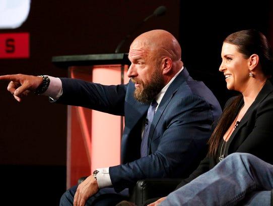 "Paul ""Triple H"" Levesque, left, and Stephanie McMahon"