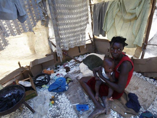 Guiléne Mandéus, 30, a married mother of four children,