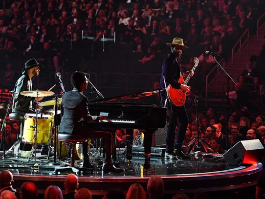 Gary Clark Jr. (on guitar), Jon Batiste (piano) and