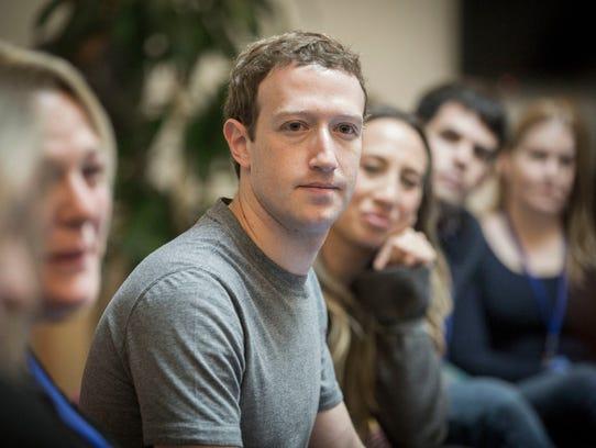 Facebook CEO Mark Zuckerberg speaks to guests at Facebook