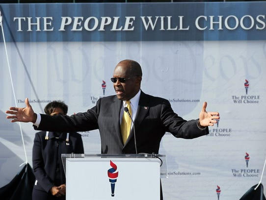 Herman Cain announces that he is suspending his campaign