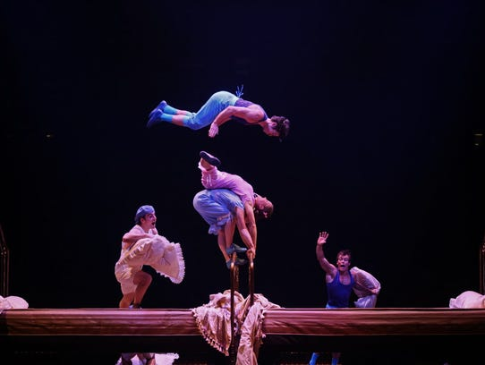 Acrobats perform using trampolines designed to look