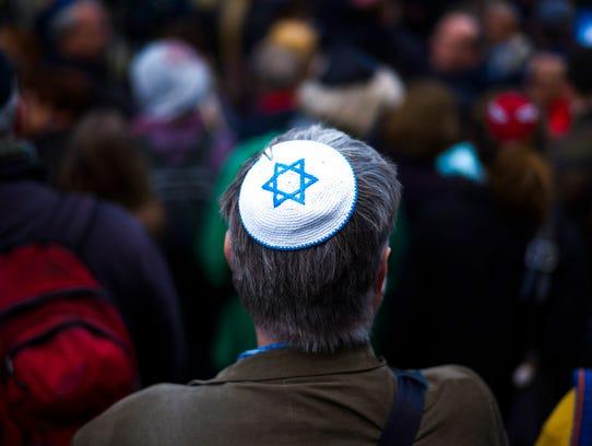 A man wears a Jewish skullcap, as he attends a demonstration