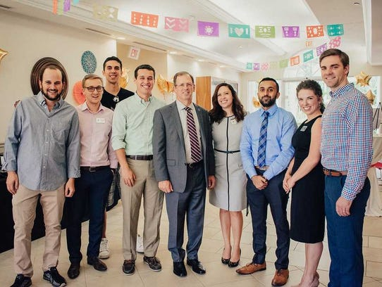 Mohad Abbass, 28, third from the right, a Muslim graduate