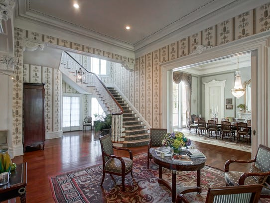 The grand staircase leads to the second floor where