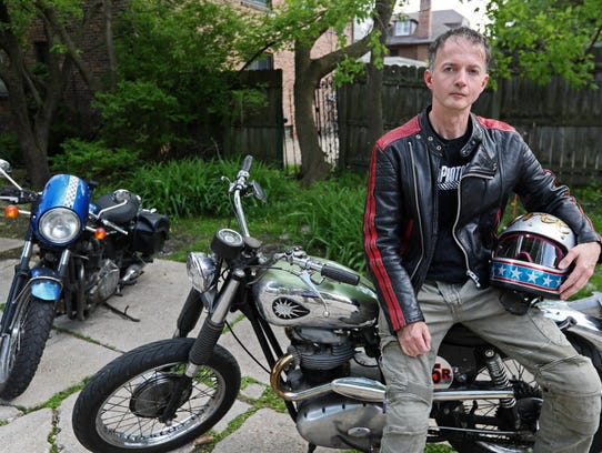 Cormac Kehoe of Milwaukee sits on his 1964 BSA Rocket,