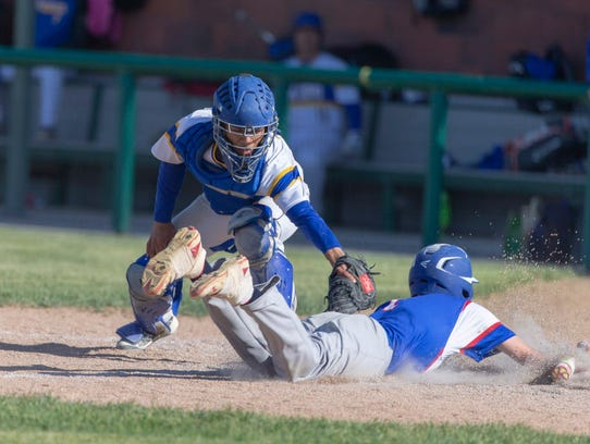 Milwaukee King catcher Tomas Pinet tags Wisconsin Lutheran second baseman Noah Biltz during the teams' sectional final June. 5. King won, 5-4.