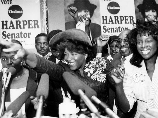 Thelma Harper waves to her supporters at her headquarters after winning the state Senate seat on election night Aug. 2, 1990.