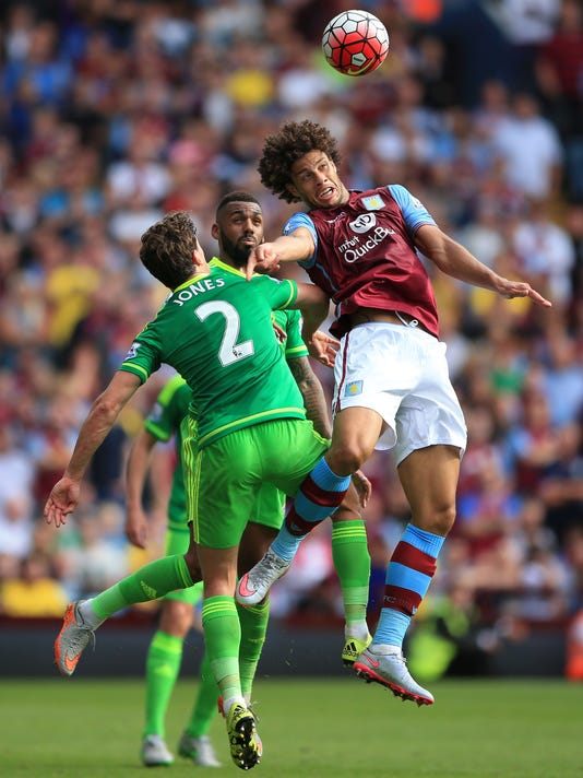 Aston Villa's Rudy Gestede, right, battles for the ball with Sunderland's Billy Jones as Sunderland's Yann M'Vila, rear, looks on during the English Premier League match at Villa Park, Birmingham, England, Saturday Aug, 29, 2015. (Nick Potts/PA via AP) UNITED KINGDOM OUT  NO SALES  NO ARCHIVE