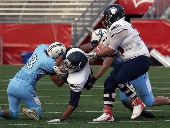Caleb Wright get tackled during the WIAA Division 2