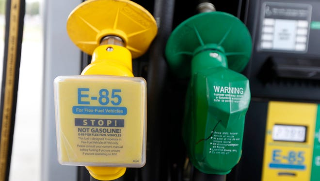 Fuel nozzles for E-85, left, and traditional gasoline are seen at a gas station.