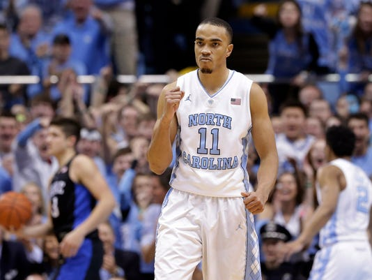 North Carolina's Brice Johnson reacts following a play during the first half of the team's NCAA college basketball game against Duke in Chapel Hill, N.C., Wednesday, Feb. 17, 2016. (AP Photo/Gerry Broome)