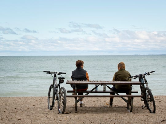 Sisters Elizabeth Sloan, of Farmington Hills, and Amy Digon, of Harrison Township, take a break from their bike trip along the local section of the Bridge-to-Bay trail Wednesday, October 14, 2015 at Lakeside Park in Port Huron. A new restroom and concessions facility and splash pad will be constructed and open by May of 2016 as part of improvements at the park.