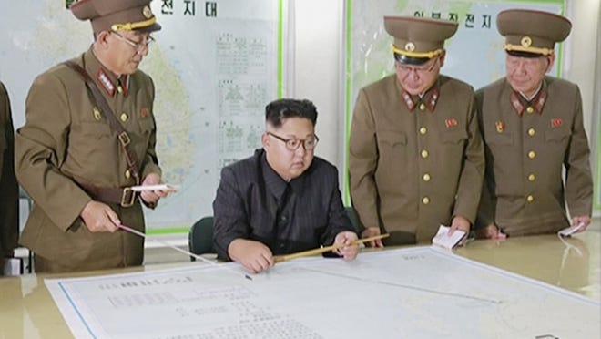 North Korean leader Kim Jong Un receives a military briefing in Pyongyang. (KRT via AP Video)