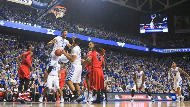Kentucky's Skal Labissiere slams two with authority over Ole Miss in the Wildcats' 83-61 win over Ole Miss Saturday.