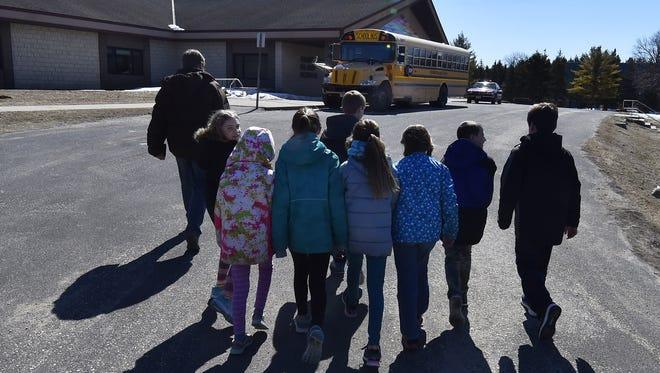 Students walk to school on Washington Island.