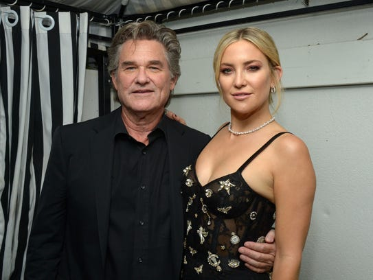 Kurt Russell poses with Kate Hudson at the Toronto