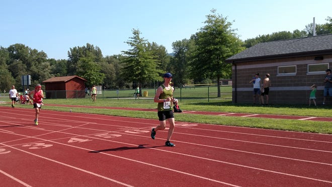 Running hard to secure a sub-1:45 finish.