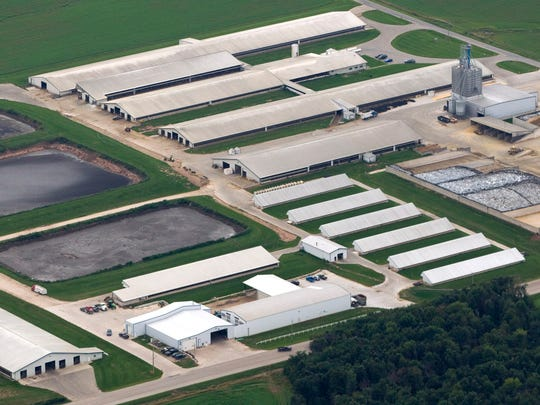 Walker administration project to battle manure pollution has been hit by delays
