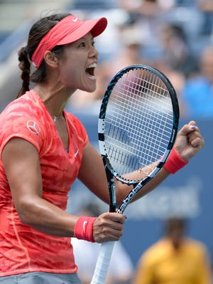 Li Na reacts after defeating Laura Robson in the third round of the U.S. Open on Friday.